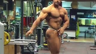 Mehdi Sabzevari posing in the gym