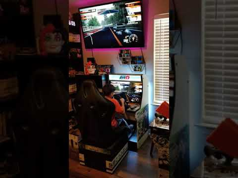 My youngest son playing the Initial D arcade cabinet I built from an Arcade1Up Galaga. from Tony Bishop
