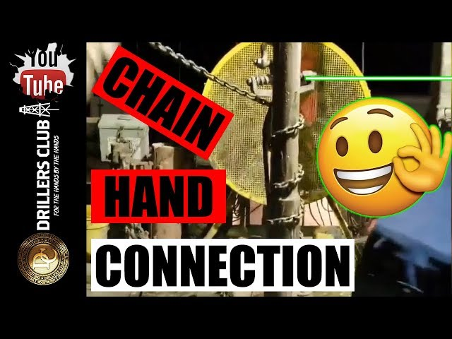 Rig Hand Makes Connection Using Chain On Drilling Rig