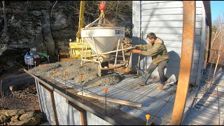 Pouring concrete on the container castle