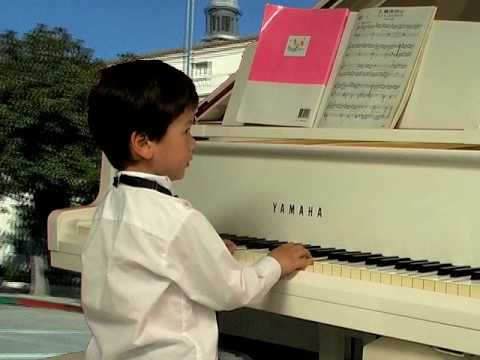 3-year old gives public piano recital