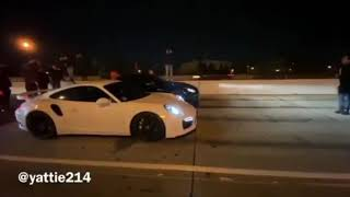 Porsche 911 Turbo VS Black Nissan GTR