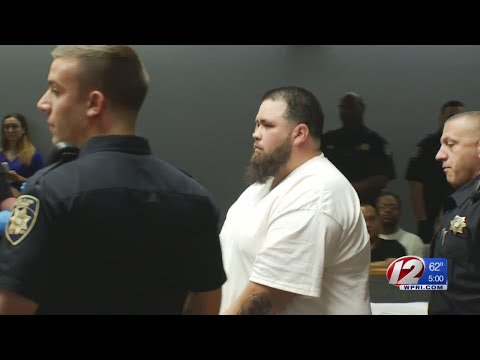 Suspected motorcycle gang leader arraigned on 221 charges