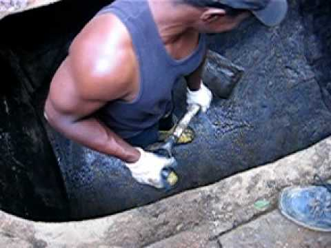 how to clean sludge from gas tank