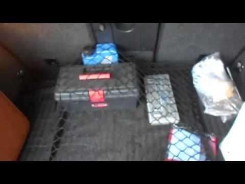 как крепить сетку в багажнике киа спортейдж