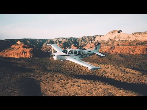 FORMATION FLYING OVER SEDONA - 2 BONANZAS AND A CITATION MUSTANG