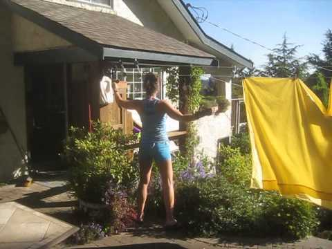Sweet  Woman Hanging Laundry on her Clothes Line