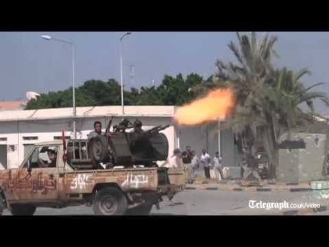 Libya conflict: rebels fight their way into Col Gaddafi's compound