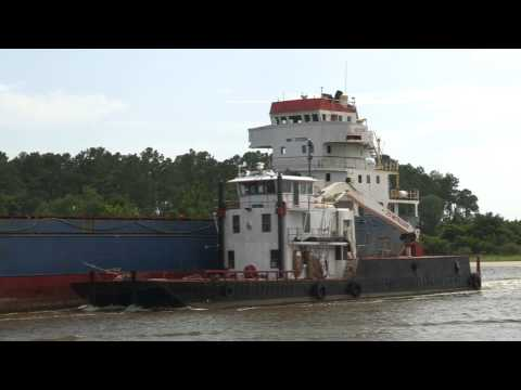 Cargo Ship travels on it's way to Orange Beach Al on canal.