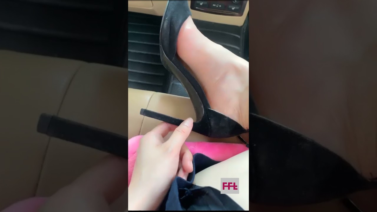 HD- close view - sexy bare feet relaxing in high heels shoes and flats in her car