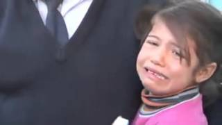 A little Syrian girl, Aisha 5 years old, selling tissues on the streets of Turkey to help her family