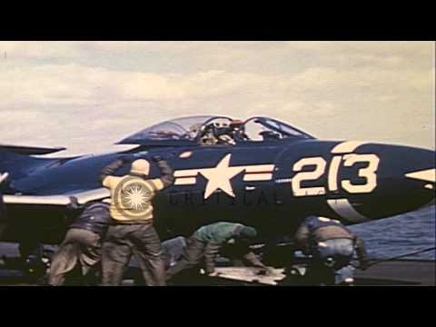 US Navy jet fighter aircraft F2H Banshee and F9F Panther on flight deck of USS Ph...HD Stock Footage