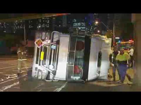 Semi-trailer topples on car