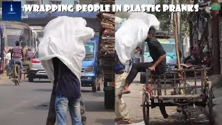 WRAPPING PEOPLE IN PLASTIC FUNNY PRANK COMPILATION [NOT FOR PEOPLE EASILY OFFENDED!]
