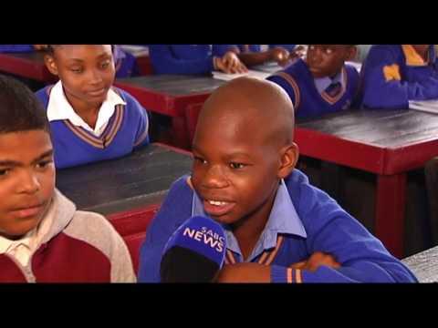 Coca-Cola and Extrupet donates classroom desks to a Soweto school