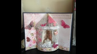 birdcage with tealight in a book