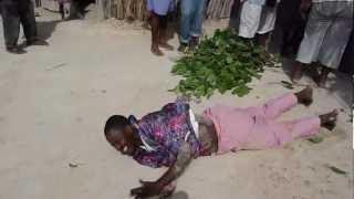 Voodoo Priest Turns into Snake in Haiti