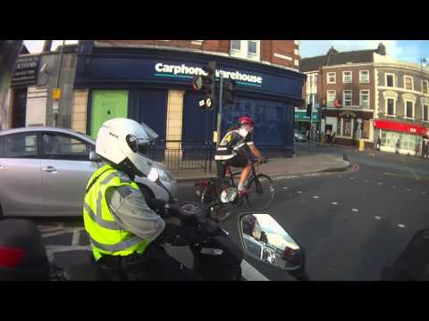 Tooting Broadway - Civil Enforcement Officer Using PDA on Scooter