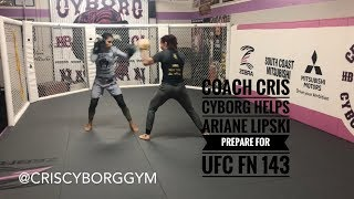Cris Cyborg holds pads for Ariane Lipski ahead of UFC FN 143