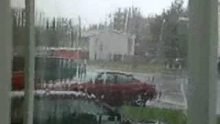 Canada Post Delivery Van Drops Off Mail During Hurricane Igor