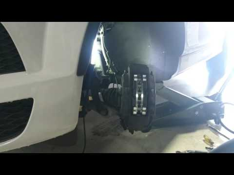 How to change the front brakes on an Audi Q7 2015 with Rotors and brake pad sensor