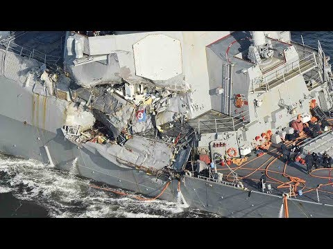 Significant damage to US Navy ship in deadly collision