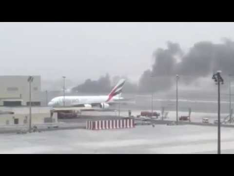 Dubai airport fire Emirates plane with 300 on board bursts into flames on runway after crash landin