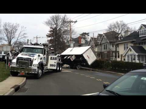 Towing crews get a milk truck upright that flipped on Field Point Road in Greenwich on Monday morning.