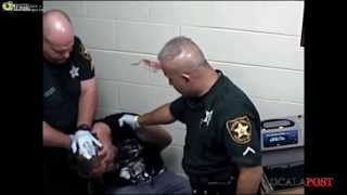 police brutality, officer slams prisoners head into concrete wall