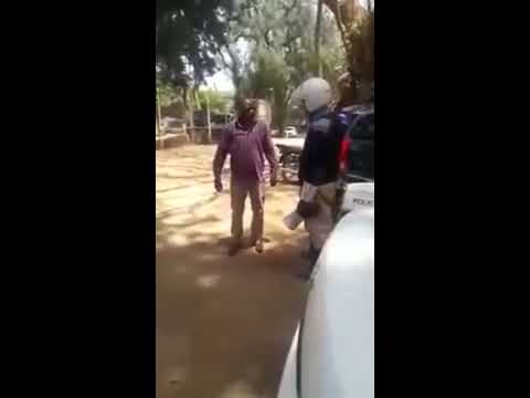 KENYA POLICE BRUTALITY Man engages in fist fight with traffic police