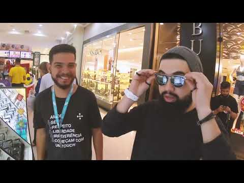DJ Cocino buying glasses and watches using SmartCash in a Brazilian shopping mall