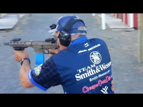 Champion shooter Jerry Miculek shooting full auto M4 rifle- Crimson Trace Midnight 3-gun