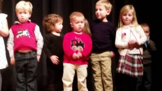 2 yr old boy kissing girl during Christmas pagent