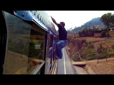 CRAZY JOBS! Bus worker climbs on moving bus in Guatemala