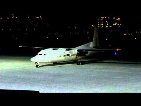 Denim Air Fokker 50 landing at Innsbruck