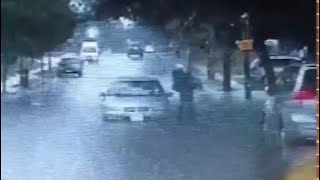 National Guard specialist rescues woman from flooded car
