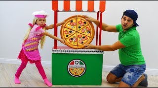 Sofia is playing a Children's kitchen Play Set and cooking Toy Food