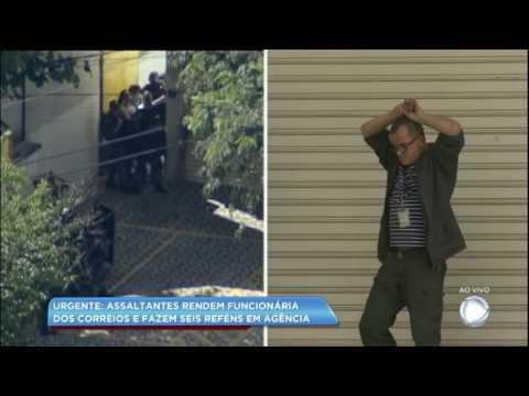 Assaltantes fazem seis reféns em agência dos Correios