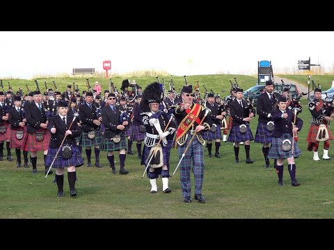 Massed pipes & drums perform Battle of the Somme and Heights of Dargai in Nairn, Scotland
