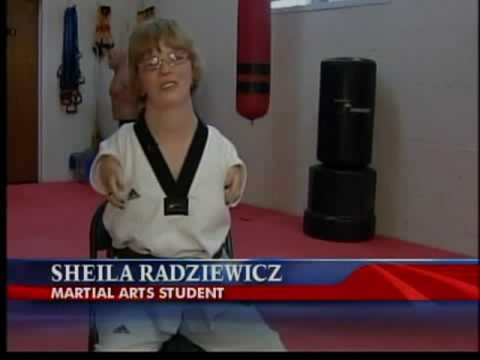 Disabled Woman defies odds by getting black belt (wheelchair)