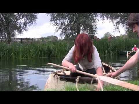 Coracles. Racing on the River Stour at Bures. Documentary