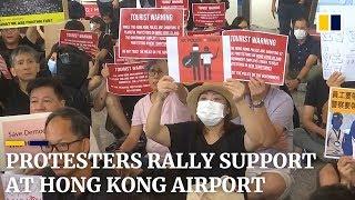Protesters rally support at Hong Kong airport