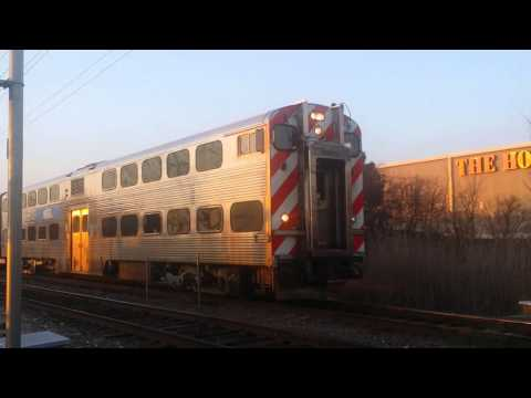 Metra MP36-3S 415 pushes inbound train number 120 through Round Lake Beach on 4/14/16