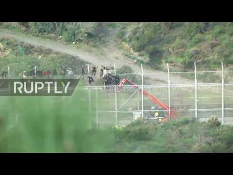 Spain: Nearly 1,000 refugees attempt to scale Ceuta border-fence