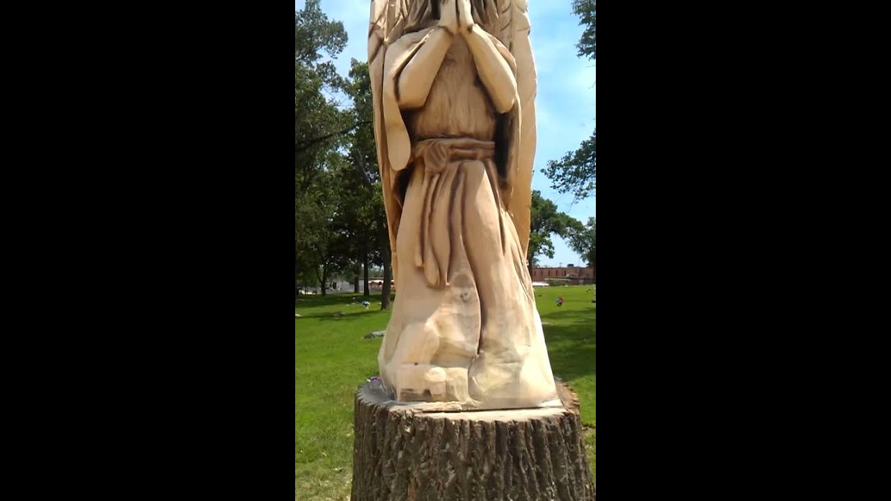 Chainsaw carved angel in cemetery youtube