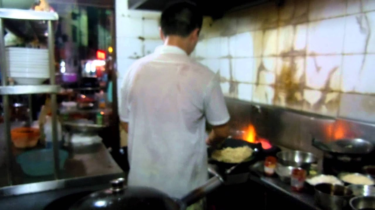 wok cooking at a fine chinese restaurant cafe in jiande city xin