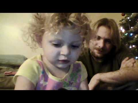 Cute little girl talking to a web cam