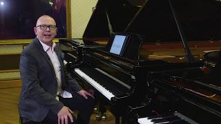 Piano lesson by Graham Fitch on relaxing the left hand, pedalling through staccato, and more