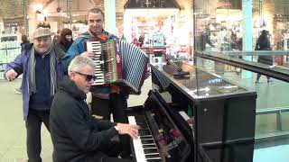 Accordion Dude Walks Past Piano Dude