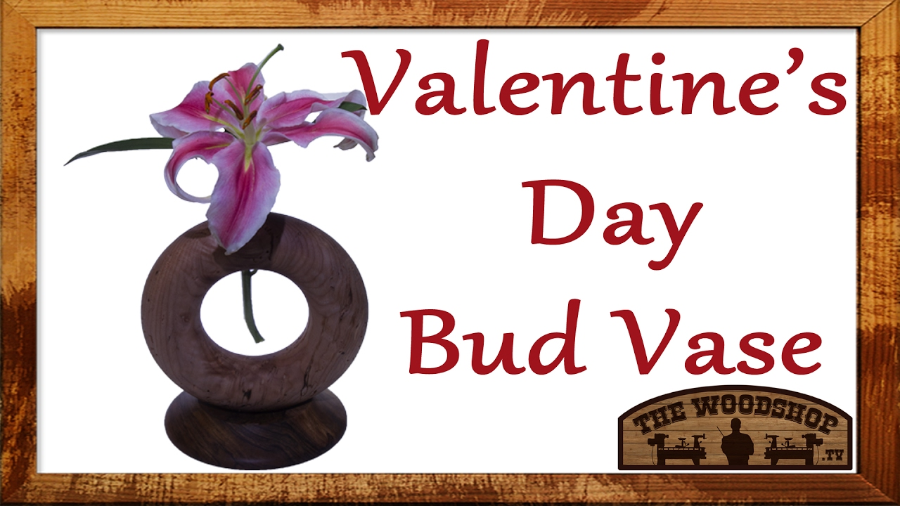 """Flower Vase For Valentine's Day / Woodturning Projects - I made this torus shaped bud vase as a Valentine's Day project. I turned both pieces on the lathe. The vase is 9 1/2"""" tall and made out of Maple and Walnut."""